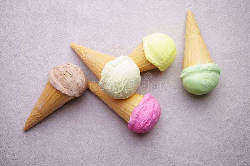 Set of various ice cream scoops in waffle cones stock photo