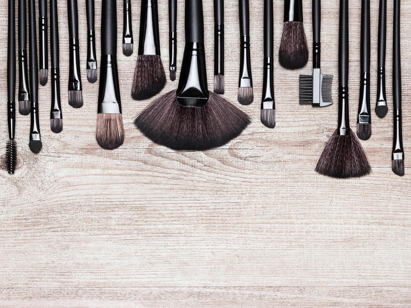 Set of various natural bristle makeup brushes. For applying foundation, powder, blush, eyeshadow, eyebrow brushes and others. Professional tools of make-up royalty free stock image