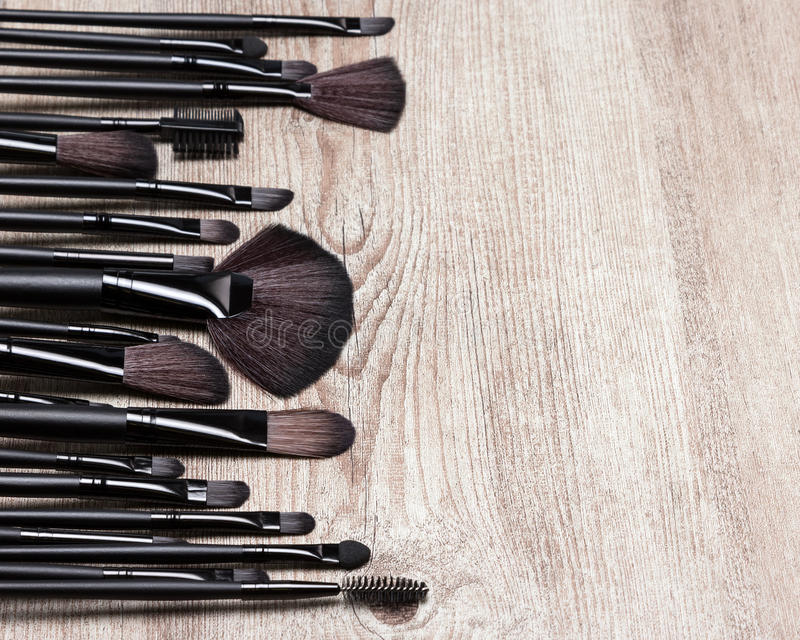 Set of various natural bristle makeup brushes. For applying foundation, powder, blush, eyeshadow, eyebrow brushes and others. Professional tools of make-up stock photos