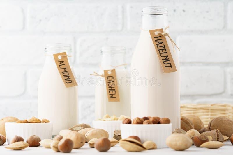 Set of various nut milk in bottles - almond, cashew, hazelnut stock photo