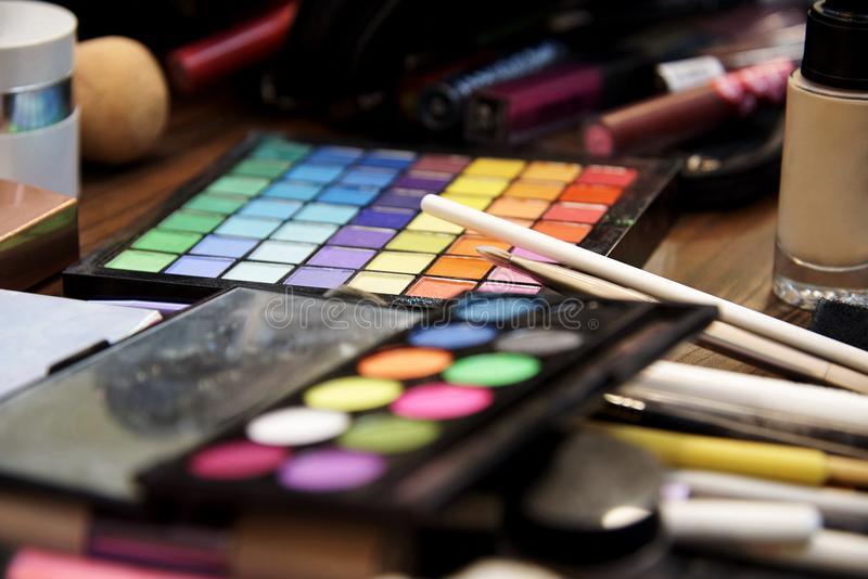 A set of various shadows, brushes and cosmetics for makeup stock photography