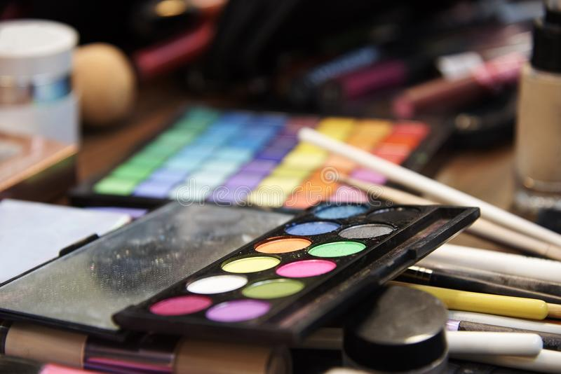 A set of various shadows, brushes and cosmetics for makeup stock photos