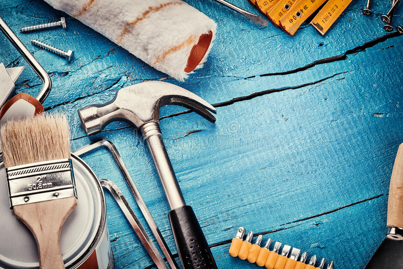Set of various tools. Construction and renovation concept. Set of various tools on blue wooden background. Construction and renovation concept with copy space stock photography