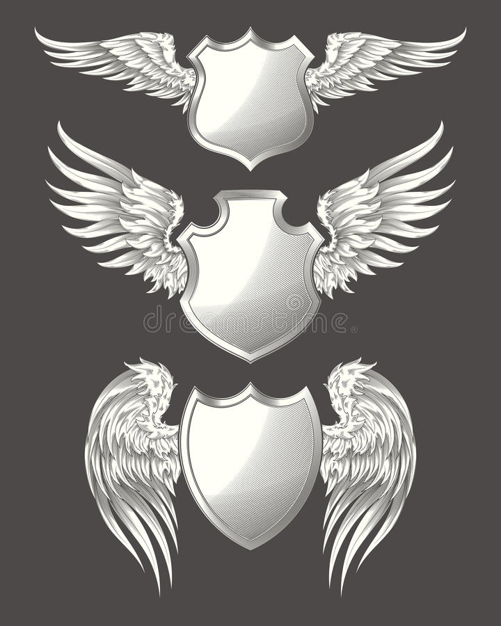 Set of vector angelic or bird wings with heraldic shields stock illustration