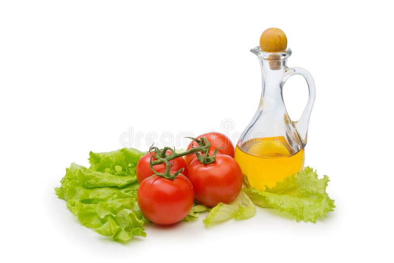 Set vegetable and jug of vegetable oil isolated on the white background royalty free stock photos