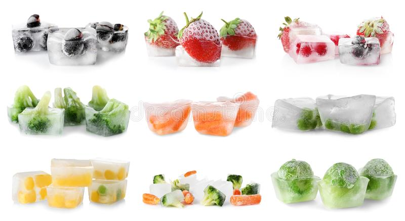 Set with vegetables and berries frozen in ice cubes royalty free stock photo