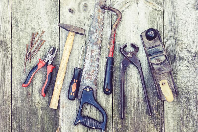 Set of vintage hand construction tools hammers with nails on a wooden background, retro concept royalty free stock photo