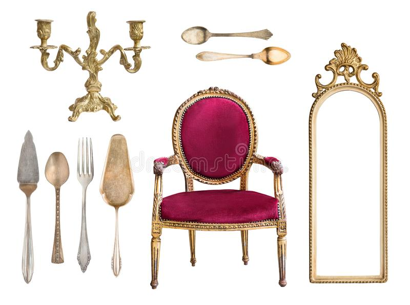 Set of 9 vintage items isolated on white background. Red chair, mirror frame, candelabrum, cutlery, spoons, forks, cake shovels stock photography