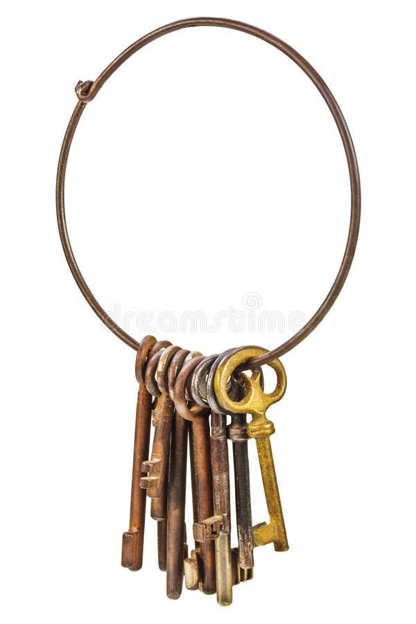 Set of vintage rusty keys on a ring isolated on white stock image