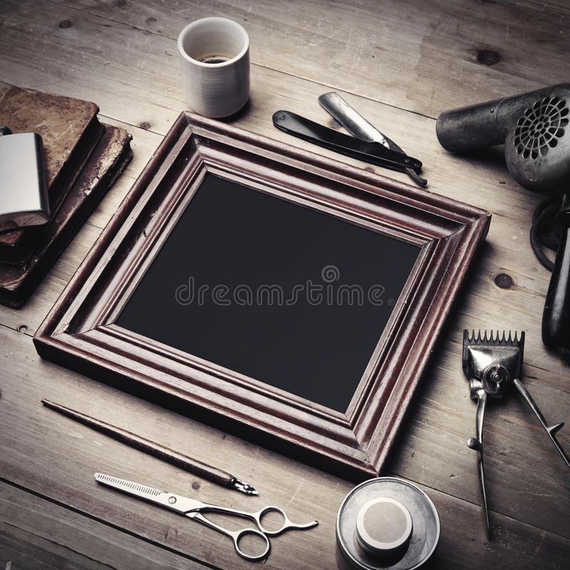 Set of vintage tools of a barber and old picture frame royalty free stock image