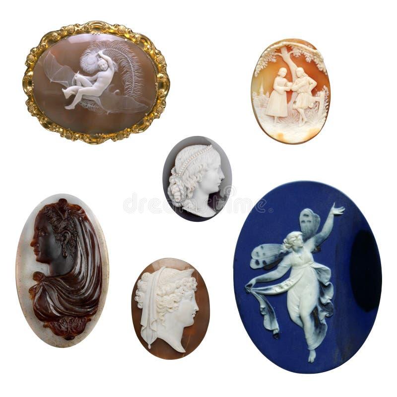 Set von sechs antiken Weinleseschmucksacheminiaturen stockbild