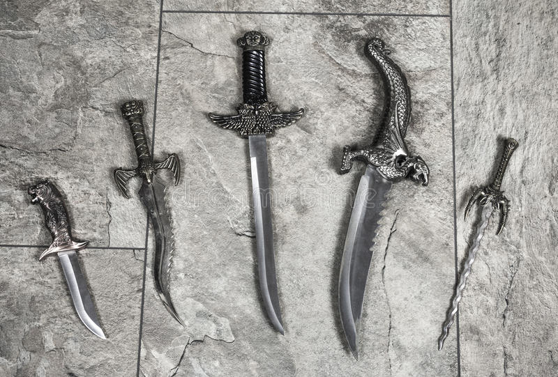 Set of War Knives. War silver medieval knives on grey background stock photo
