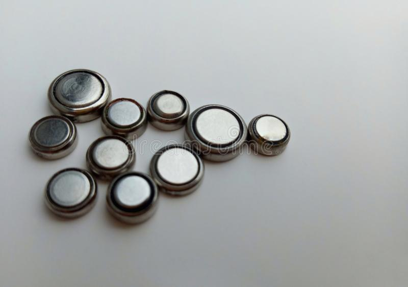 A set of watch batteries. Isolated by a white background, objects, battery, bunch, button, cell, charge, circle, circular, coin, current, device, digital stock image