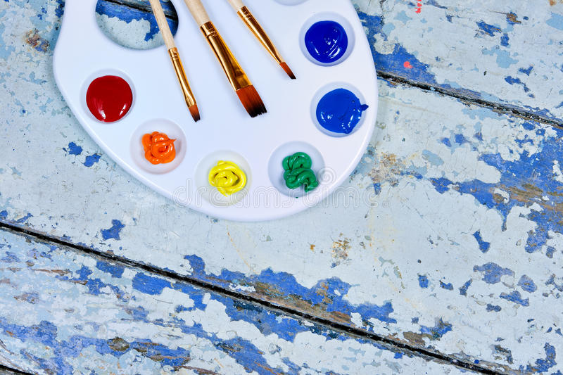 Set of watercolor aquarell rainbow paints and brushes on vintage. Wooden background. Top view royalty free stock photography