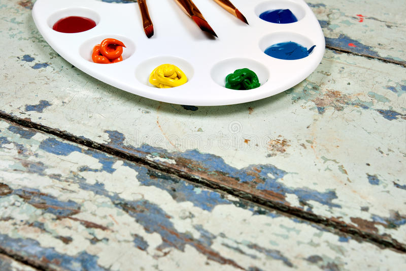 Set of watercolor aquarell rainbow paints and brushes on vintage. Wooden background. Top view stock images
