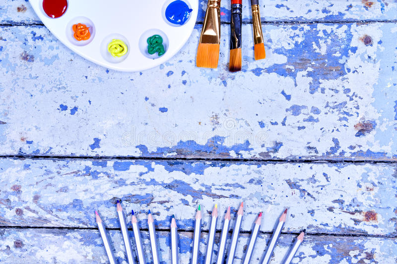Set of watercolor aquarell rainbow paints and brushes on vintage. Wooden background. Top view royalty free stock image