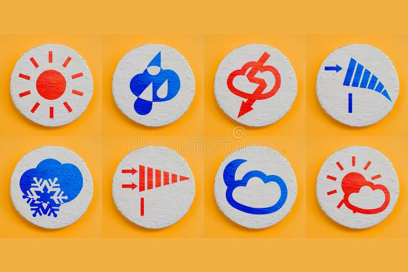 Set of weather forecast icons for web site or mobile application. Realism design concept. Red and blue painted symbols on white. Texture coating round surface stock photo