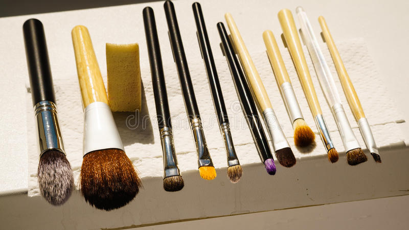 Set of wet makeup brushes after washing drying stock photos
