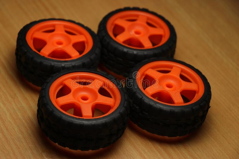 Set of wheels used for mini projects. Set of four wheels used in hobby projects such as remote control car and in other radio controlled toys stock images