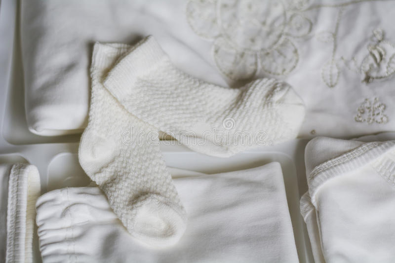 Set of white baby clothes royalty free stock images