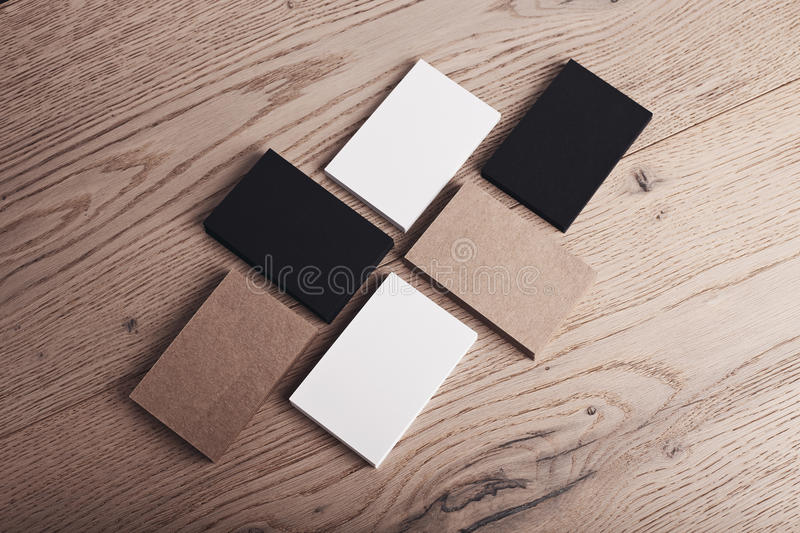 Set of white, black and craft business cards on wood table. Horizontal royalty free stock photography