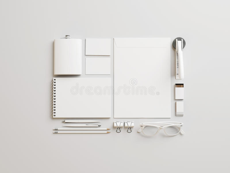 Set of white branding elements on paper background royalty free stock photo