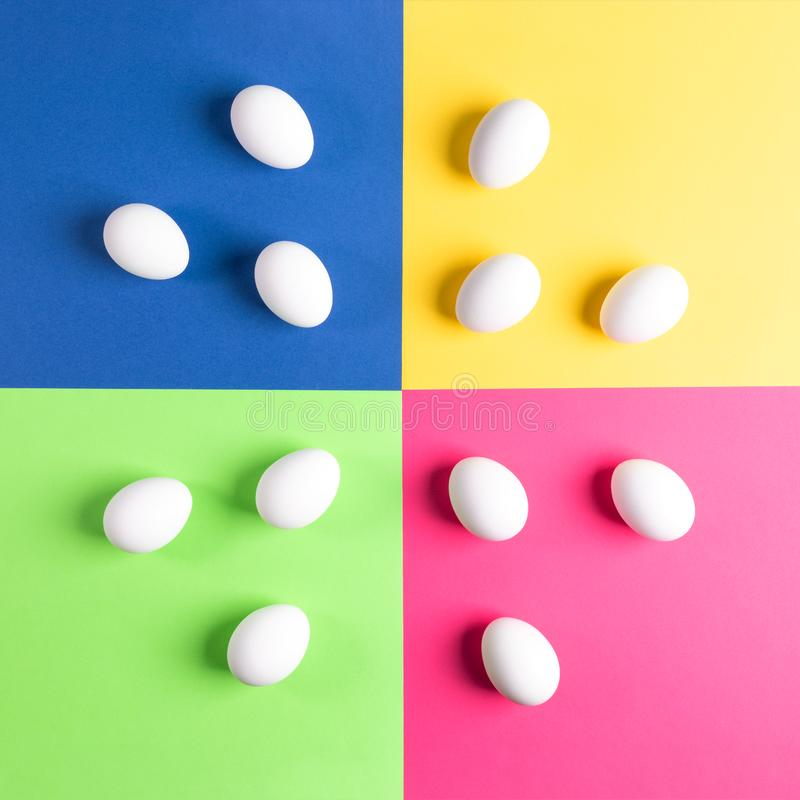 Set of white eggs on colorful four-color background. royalty free stock photo