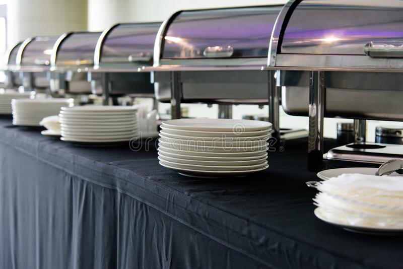 Set of white plates on the table royalty free stock photo