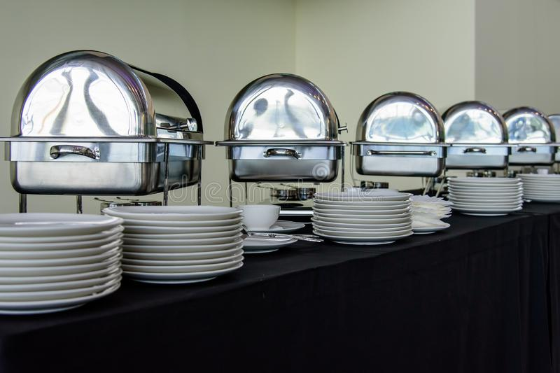 Set of white plates on the table stock photo