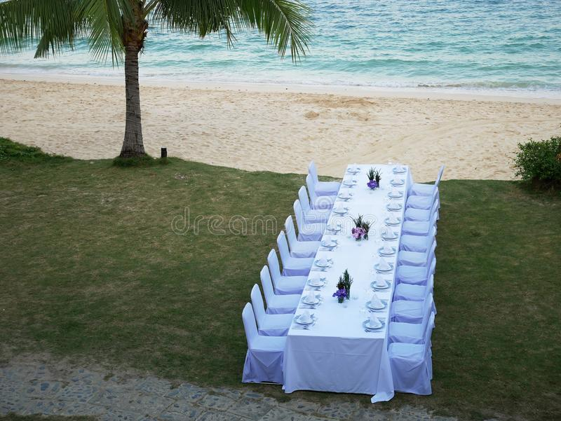 Set of white table and chairs for private dinner party. stock image