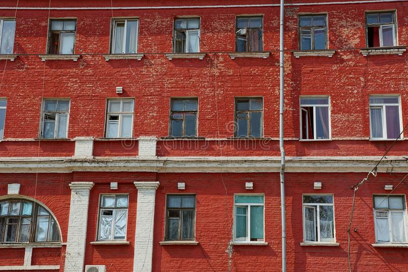Set of windows on a red brick wall of an old building royalty free stock photography