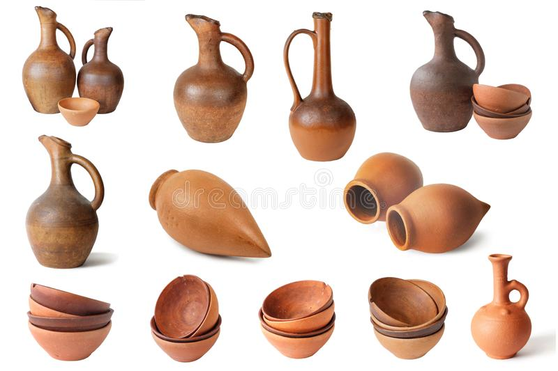 Set of  wine jugs and clay cups. On a white background, isolated stock photo