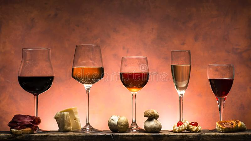 Set of wines and food. Set of different types of wines with food pairing royalty free stock image