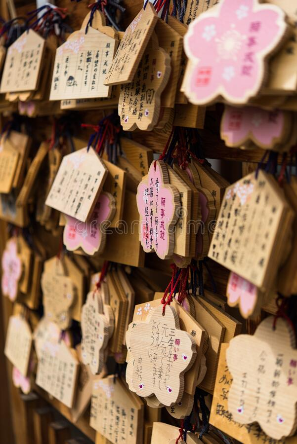 Wishes and prayers written outside temple in Japan royalty free stock image