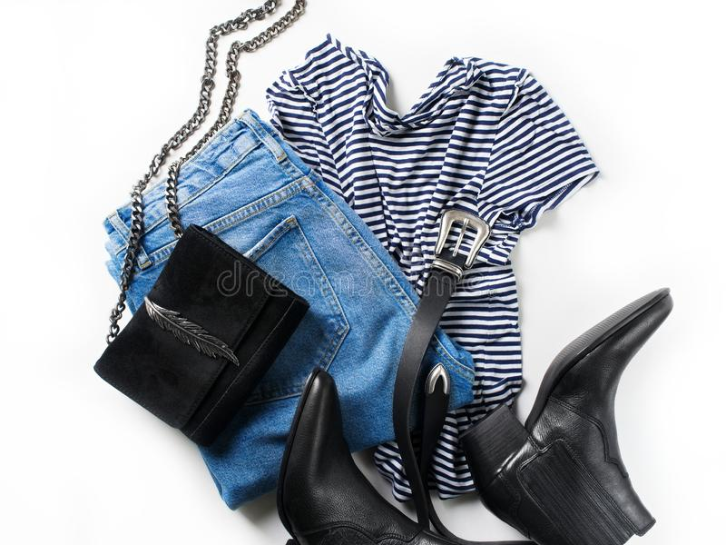 Set of women`s outfit - jeans, western boots, bag, belt and str stock image