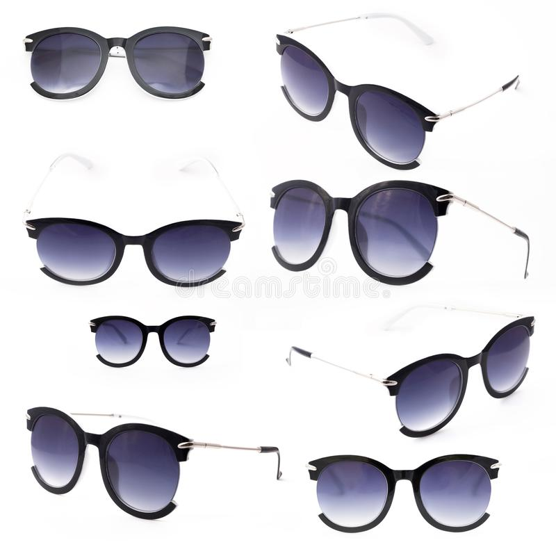 Set of women`s sunglasses with purple tint stand frontally isolated on a white background with a shadow. Glasses rotated to the left royalty free stock images