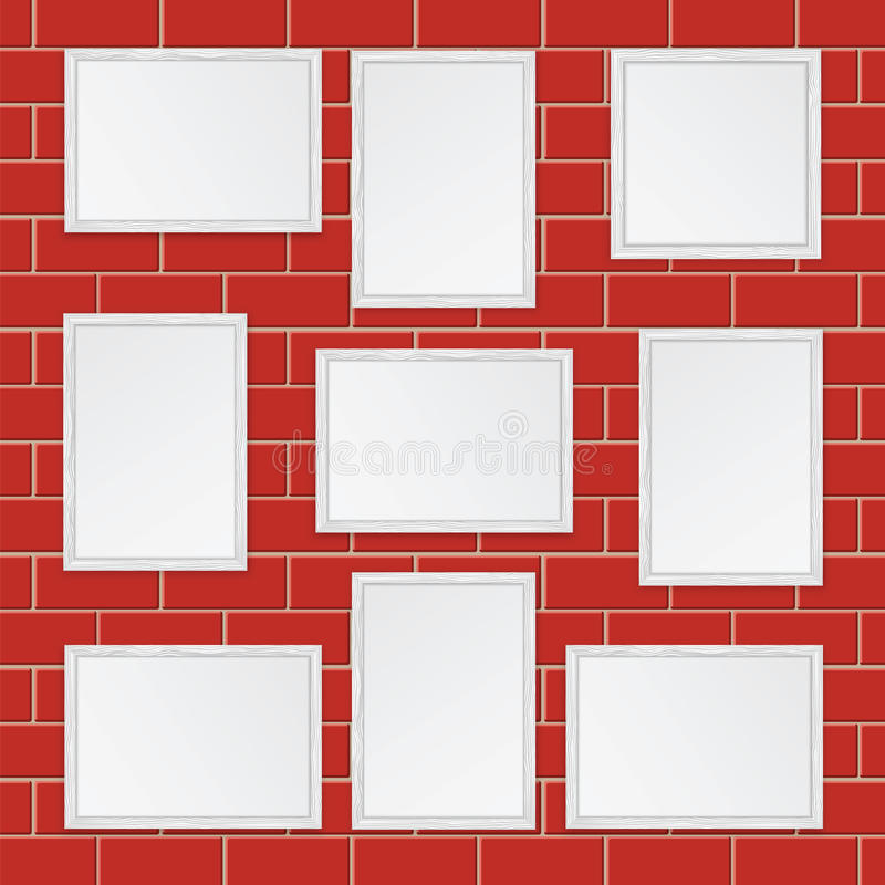 Set of wooden frames. On the wall of red bricks royalty free illustration