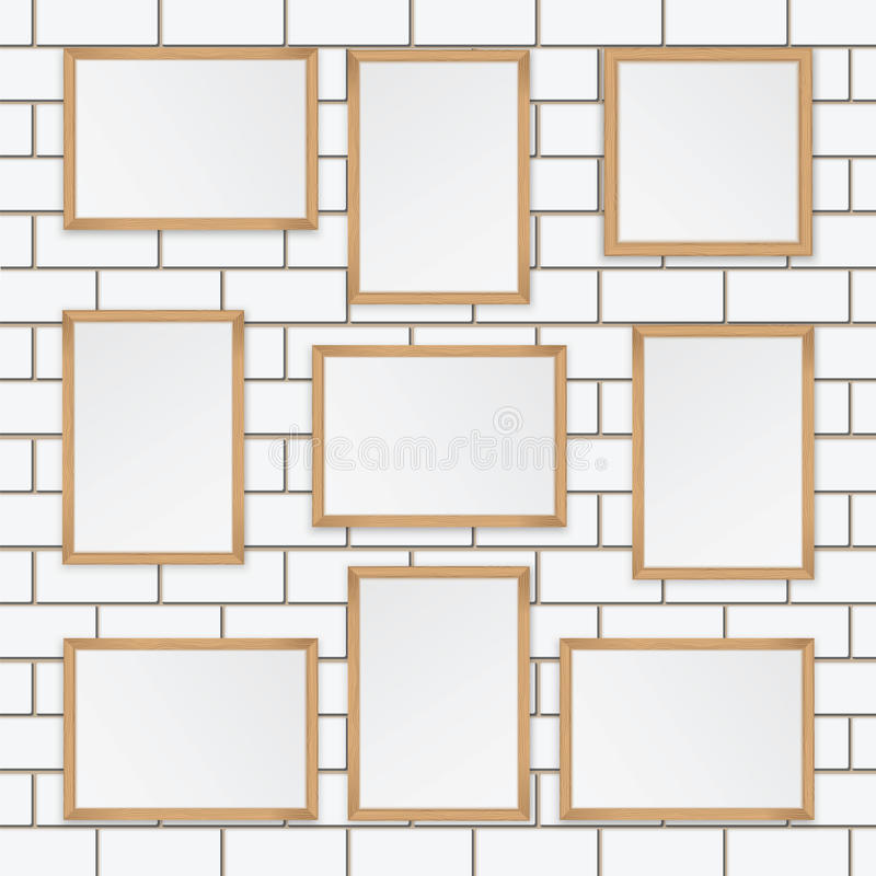 Set of wooden frames. On the wall of white brick stock illustration