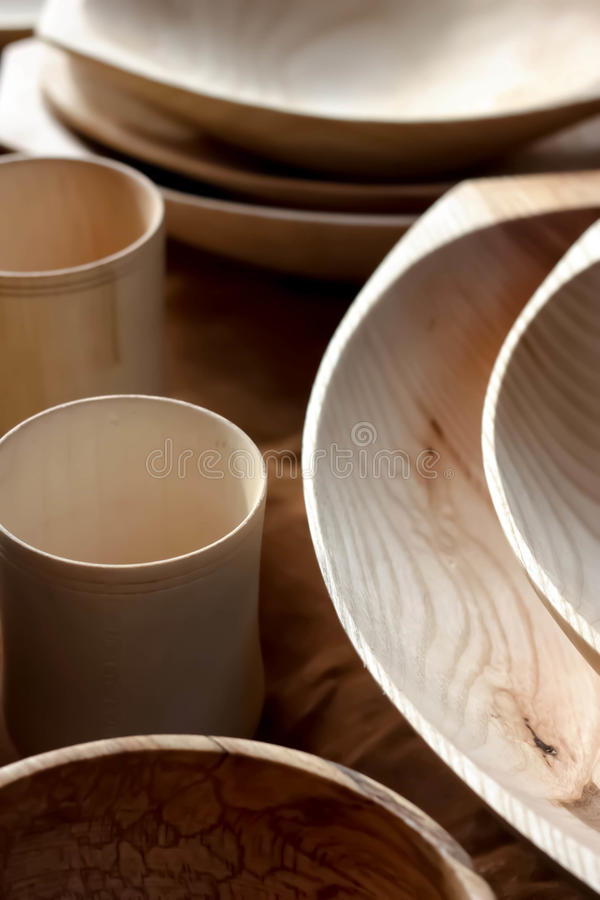 Set of Wooden Plates. Bowls and mugs stock images