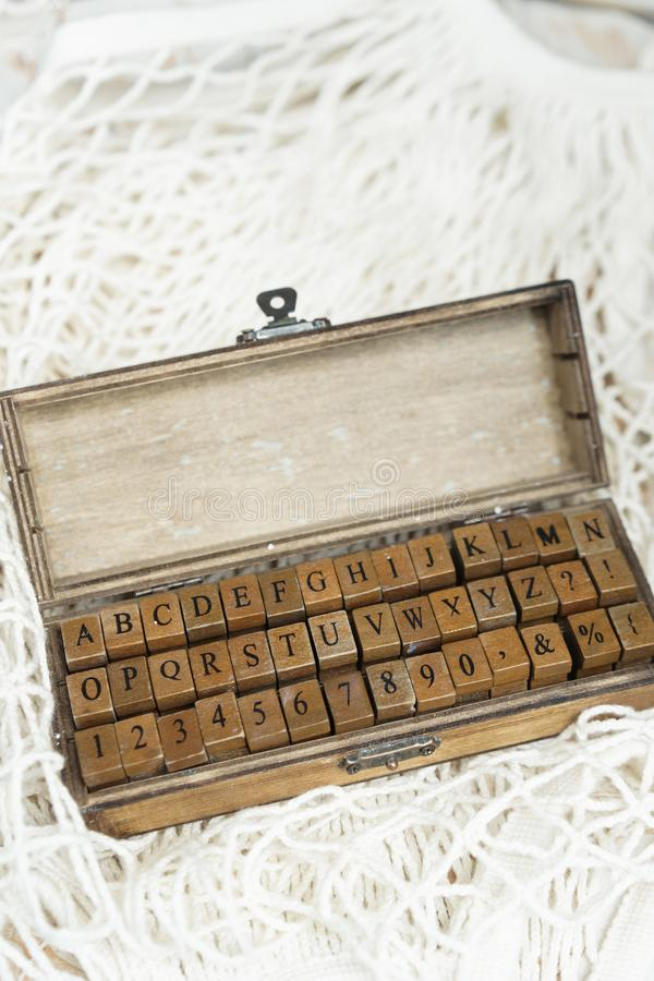 Set of wooden stamps of the English alphabet and numbers in a wooden box.  stock photo