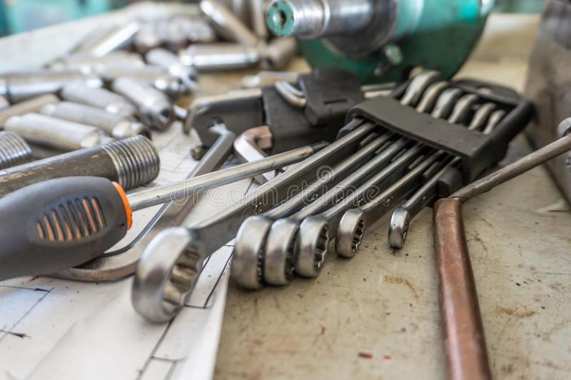 A set of working tools of a repairman`s fitter, open-end wrenches and screwdrivers are in a metal box during the repair process royalty free stock images