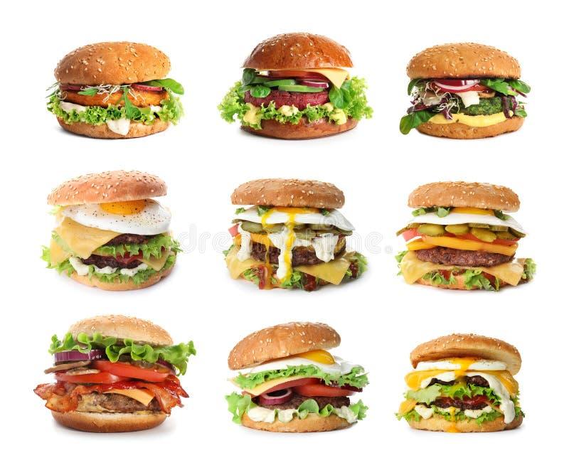 Set wyśmienicie hamburgery na bielu obrazy stock