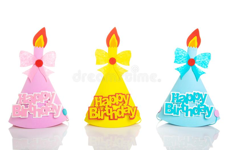 Set of Yellow, Blue and Pink Birthday hat with elements and decorations for party and celebrations isolated in white background.  royalty free stock photo