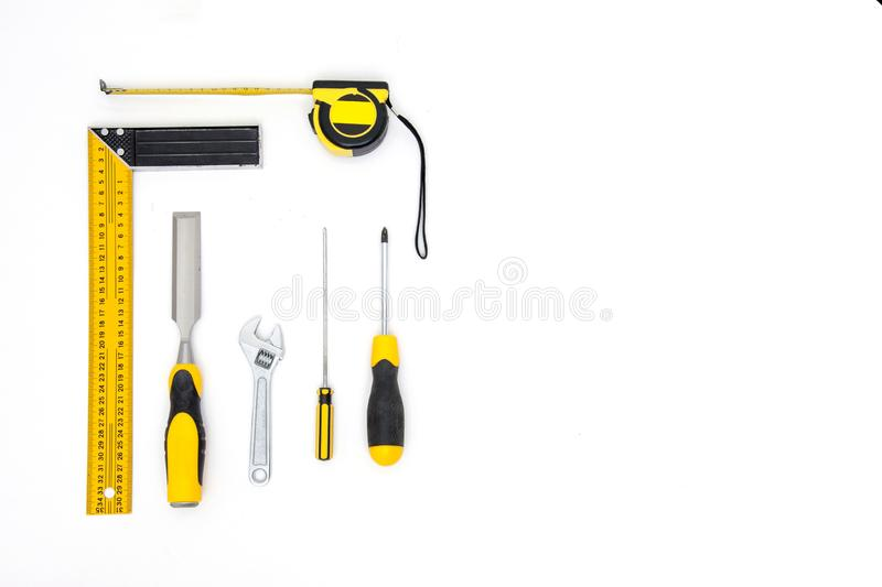 Set of yellow tools on white background top view. carpenter working table. carpentry and woodwork industry flat lay stock image