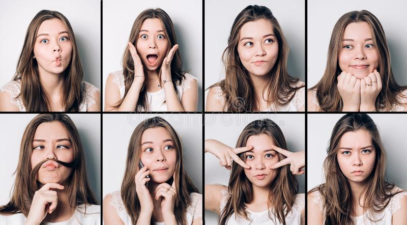 Set of young girl emotions. Casual brunette woman grimacing and gesturing on camera, at gray studio background. Set of young girl emotions. using mobile royalty free stock photography