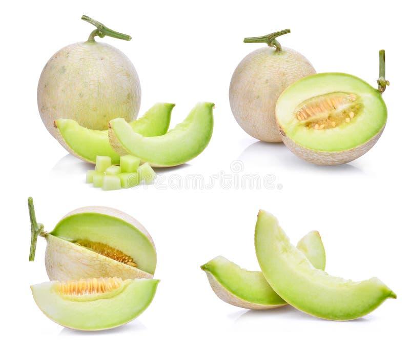 Set zielony kantalupa melon z plasterkiem i sześciany odizolowywający obrazy royalty free