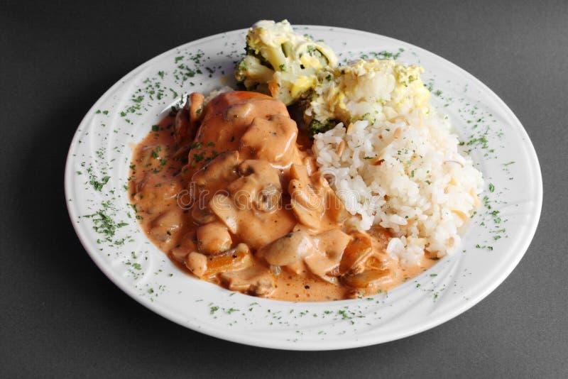 Setas y arroz de la comida imagen de archivo
