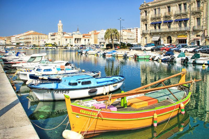 Sete, France. March, 12, 2015: Fisherman boats and The Consular Palace at the Royal Channel in Sete, south of France royalty free stock photo