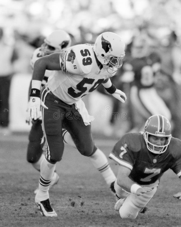 Seth Joyner knocks the ball out of John Elway`s hands. Image taken from b&w negative stock photo