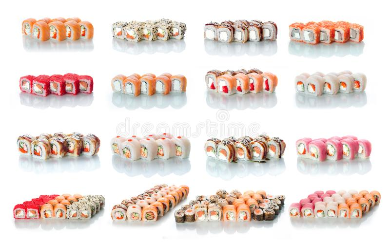 The sets of rolls of sushi collage a lot different on a white background in different colors for the menu or website. The sets of rolls of sushi collage is a lot royalty free stock photo